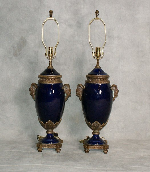Pair of bronze and cobalt blue porcelain urns mounted