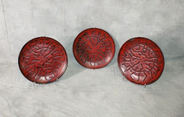 Three 15th C Chinese red and black laquered plates.