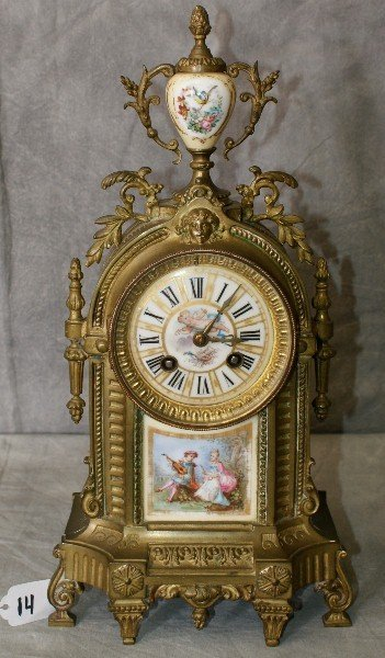 19th C bronze and porcelain  clock marked AD. Mougin