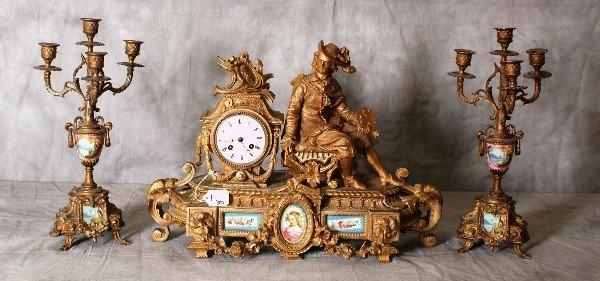 Three piece 19th C bronzed clock set with porcelain