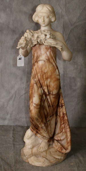 Antique marble two tone colored statue of woman holding