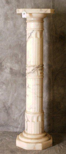 "Marble pedestal. H:39"" W:10.5"" D:10.5"""