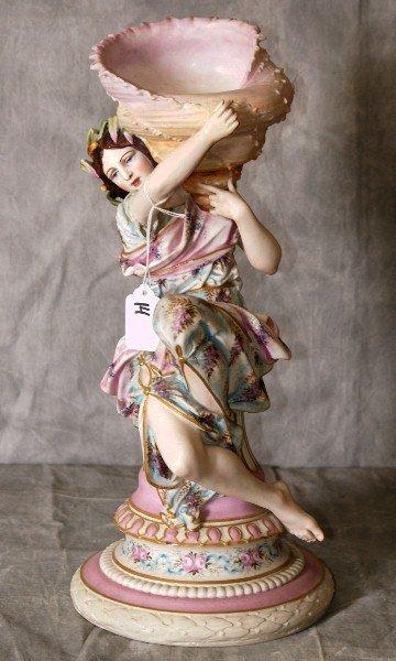Painted Parian porcelain figure holding a seashell,