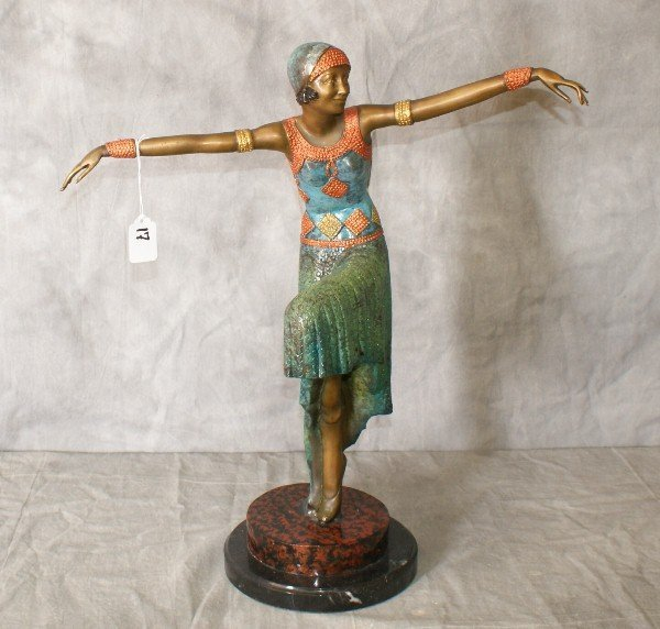Polychrome painted bronze of a woman on a marble base.