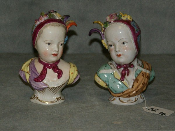 Pair Meissen porcelain painted busts of girls, marked