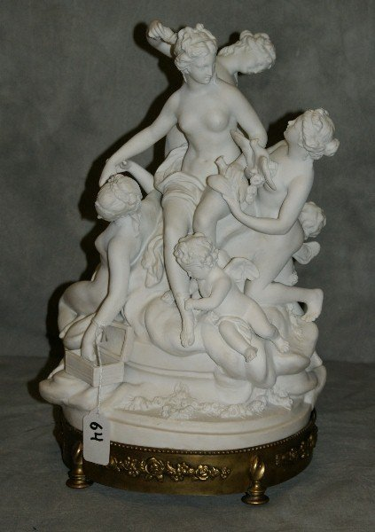 Large Severs bisque nude figural group on bronze base.