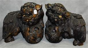 Pair Chinese 19th c Carved hardwood foo dogs with