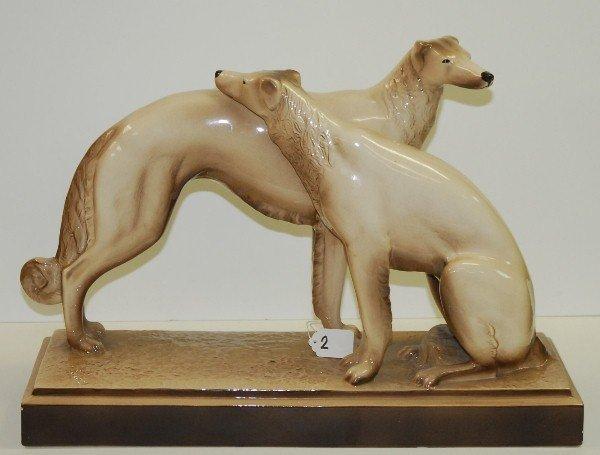 """Pair Deco porcelain dogs. H:15"""" L:21"""""""