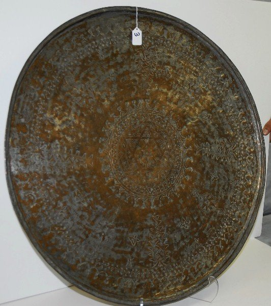Large antique copper tray with center being a star of