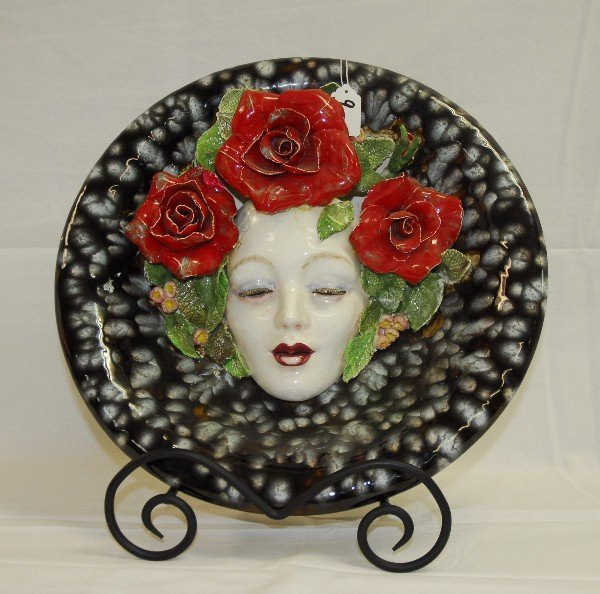 Hannd painted face plate in relief. D:15.75""