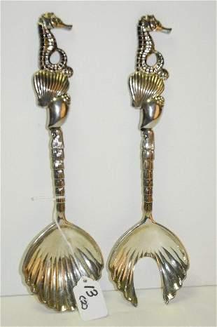 pair silver plate godinger sea horse design salad set.