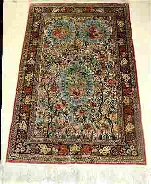 Persian silk oriental rug.