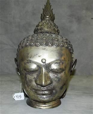 "Silvered metal Buddha head. H:16.5"""