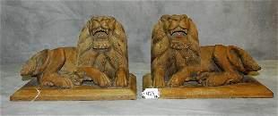 """Pair Burmise carved wood lions. H:9"""" L:14"""" D:8.5"""""""