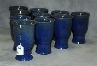 10 North Carolina pottery mugs signed on bottom.