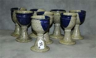 8 North carolina pottery Goblets signed on bottom.