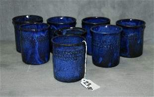 "8 North carolina pottery cups signed on bottom. H:3.5"""