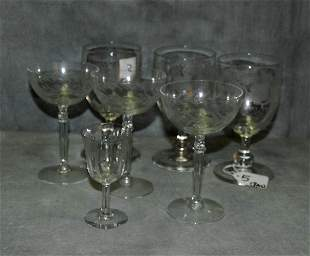 7 etched glasses. .