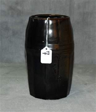Early brown glazed jar .