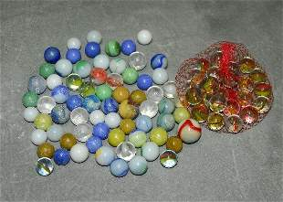 Small container of assorted glass marbles. .