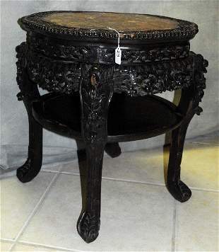 Large 19th C Chinese carved hardwood marble top table.