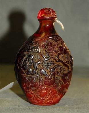 Chinese carved amber snuff bottle with raised chop mark