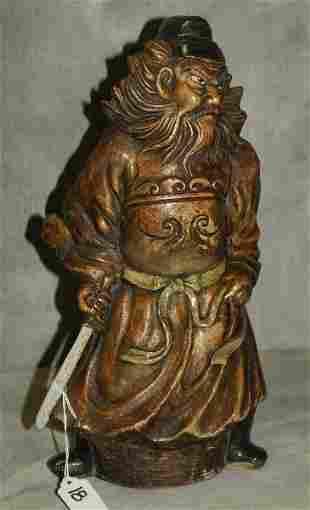 Antique Japanese glazed ceramic figure of a samural.