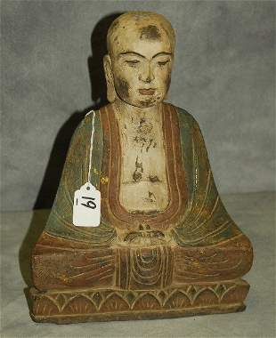 Chinese carved and polychrome wood figure of a Buddha.
