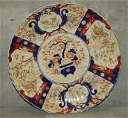 Large antique Imari porcelain charger with repair.