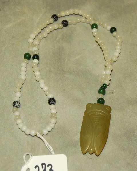 Chinese white jade beaded necklace with jade pendant.