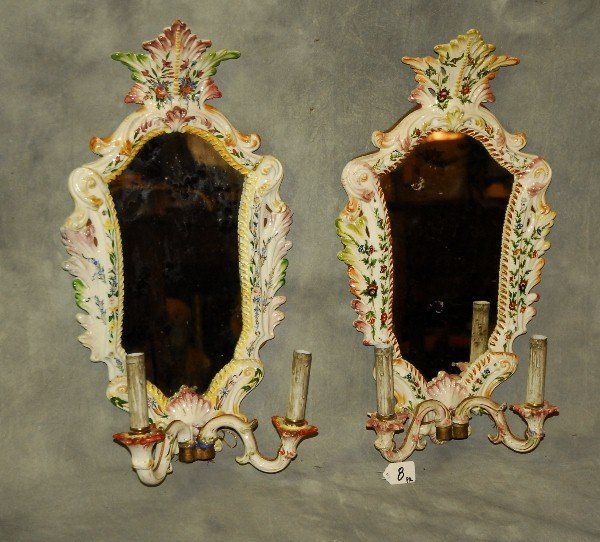 Pair antique French Faience girondole mirrors.