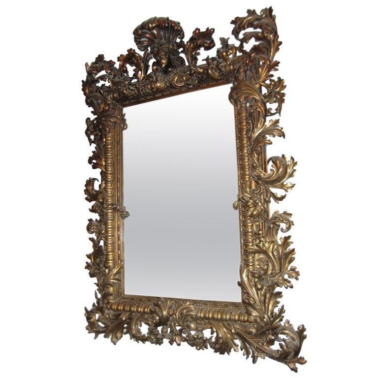 18/19th C heavily carved Rococo carved wood mirror.