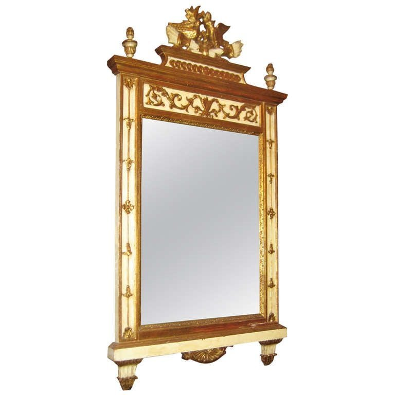 Italian carved painted and partial gilt wood mirror.