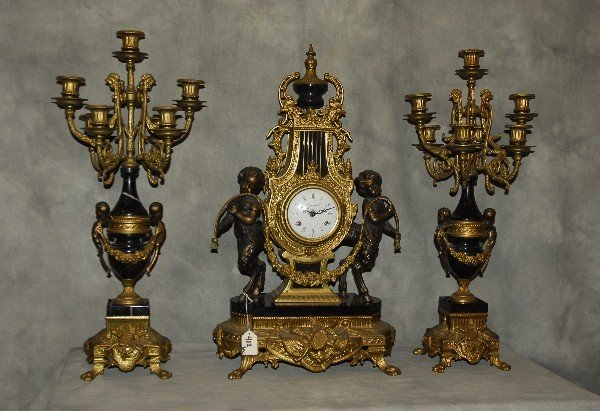 Three piece bronze and marble figural clock garnitue