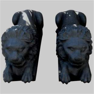 """. Pair of cast iron reclining lion figures. H:19"""""""