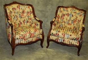 . Pair French carved and upholstered arm chairs.
