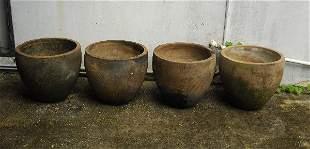 ". Four large terrecotta planters. H:18"" D:20"""