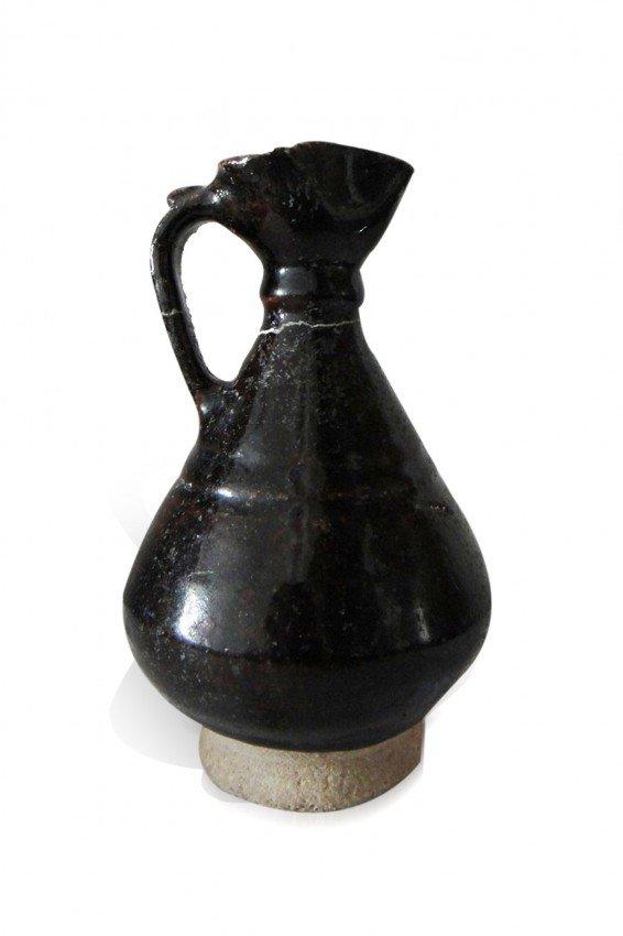 1: A BLACK GLAZED POTTERY JUG IRAN CIRCA 11TH/ 12TH  CE