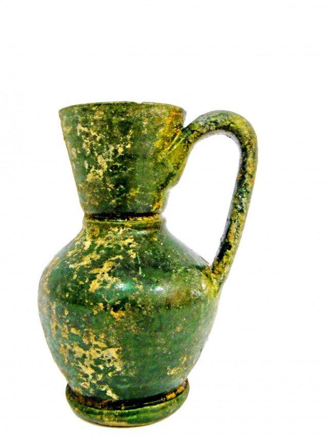 3: An Early Islamic Green & Yellow Splashed Glazed Pott