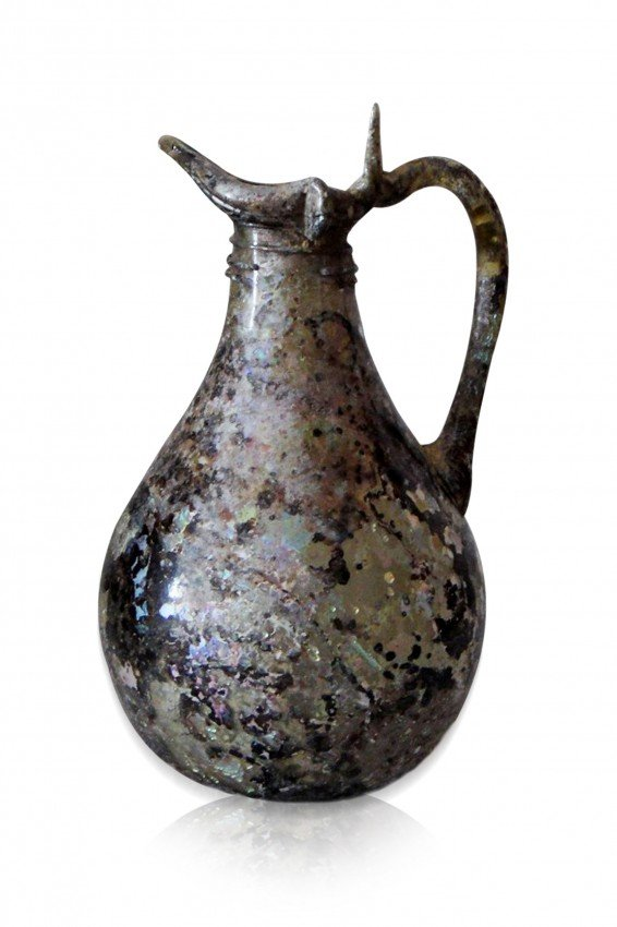 18: AN IMPORTANT INTAGLIO GLASS EWER ,PERSIA 10TH CENTU