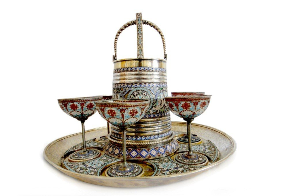 54: RUSSIAN GILDED SILVER &SHADED ENAMEL LIQUEUR SET