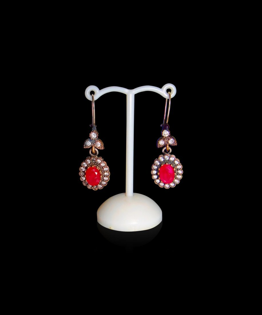 A Pair Of Sterling Silver Zircon & Ruby Earrings .