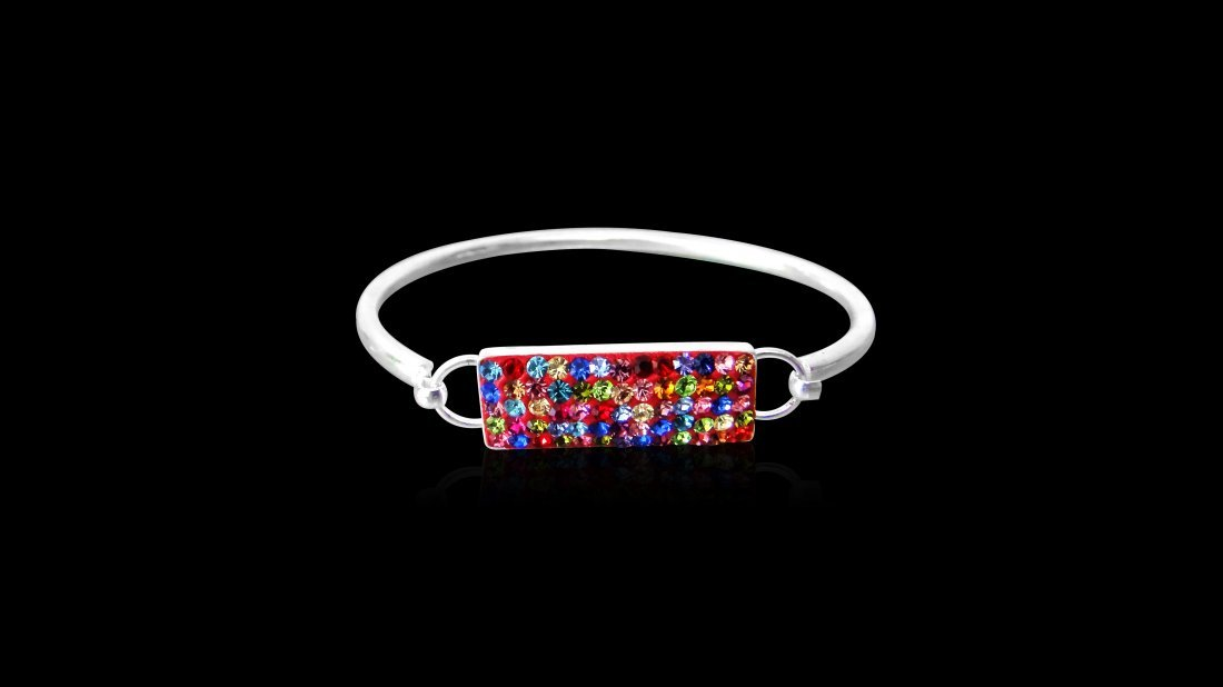 A Sterling Silver Bangle With Multi Colored-Stones .