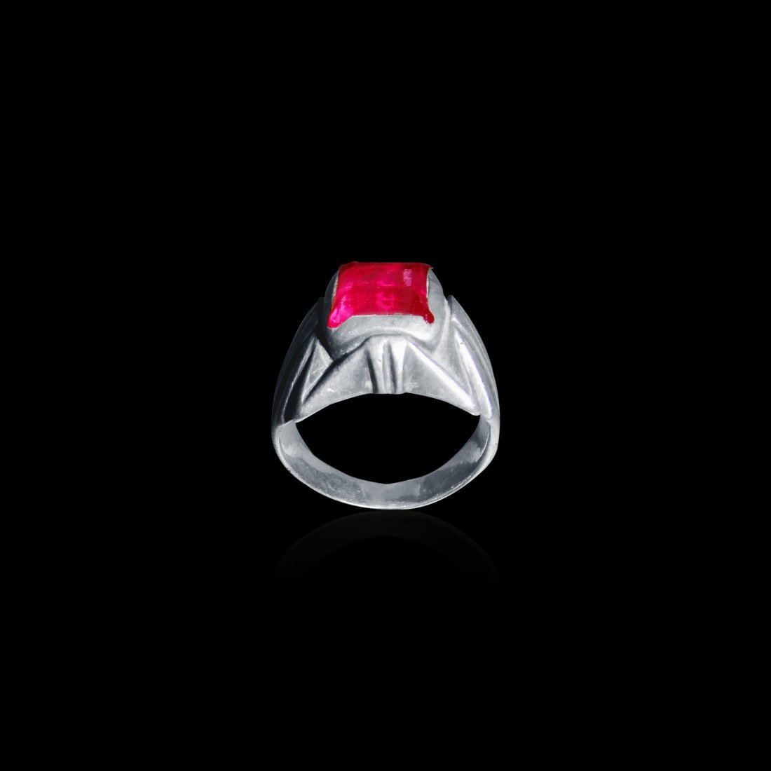 A Star Shaped Sterling Silver Ring With Red Blood Ruby