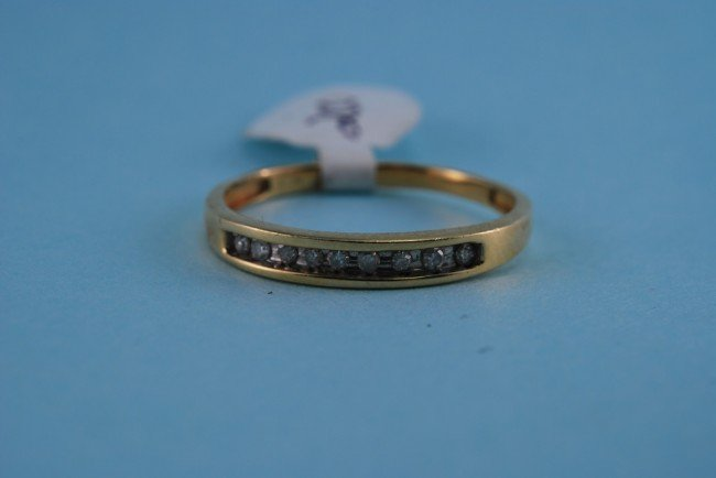 11: 417 White Gold Diamond Channel Ring. Solid gold.