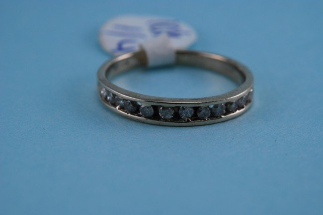 14: 417 White Gold Diamond Channel Ring. 1.6 grams. Dia
