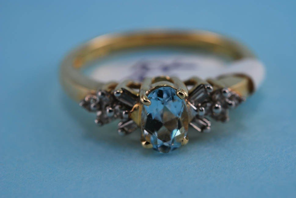 10: 417 Yellow Gold Diamond and Blue Topaz Ring. Solid