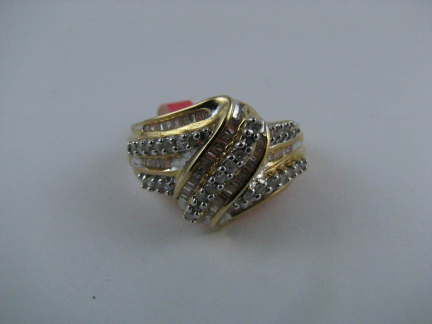 146: 10k  Gold and Diamond Ring. Solid Gold.