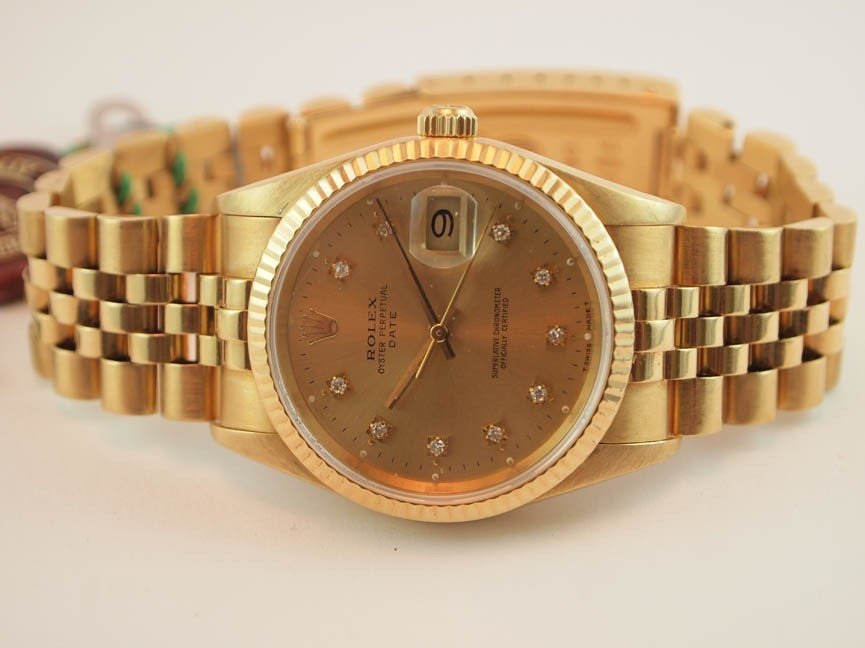 6: 18k Rolex Mens Date with Jubilee Bracelet. AM Diamon