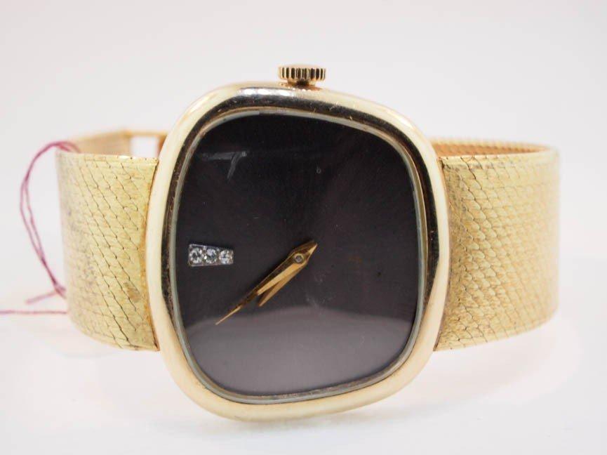 1: Baum & Mercier 14k Diamond Watch.